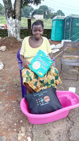 Martha is delighted to receive her UNFPA mama and baby kit ©UNFPA Sierra Leone/2017/Salim Kamara