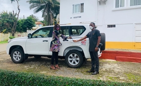 Dr. Kim Eva Dickson handing over the keys to the vehicle to Dr. Francis Moses